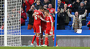 Nottingham Forest's Henri Lansbury is congratulated after his goal during the Sky Bet Championship match between Brighton and Hove Albion and Nottingham Forest at the American Express Community Stadium, Brighton and Hove, England on 7 February 2015. Photo by Phil Duncan.