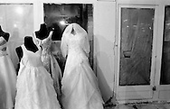 Weddingdressses on display in a local shoppingarea in the city center of Tehran. Iran, 2007