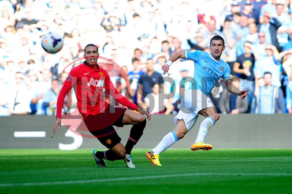 Manchester City's Aleksandar Kolarov crosses the ball into the box - Photo mandatory by-line: Dougie Allward/JMP - Tel: Mobile: 07966 386802 22/09/2013 - SPORT - FOOTBALL - City of Manchester Stadium - Manchester - Manchester City V Manchester United - Barclays Premier League