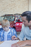 Father with his child signing documents of car