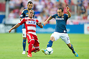 FRISCO, TX - AUGUST 11:  Landon Donovan #10 of the Los Angeles Galaxy and David Ferreira #10 of FC Dallas battle for the ball on August 11, 2013 at FC Dallas Stadium in Frisco, Texas.  (Photo by Cooper Neill/Getty Images) *** Local Caption *** David Ferreira; Landon Donovan