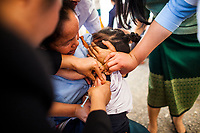 Children receive JE vaccinations after the opening ceremonies of the campaign in Xieng Khouang province, Laos.
