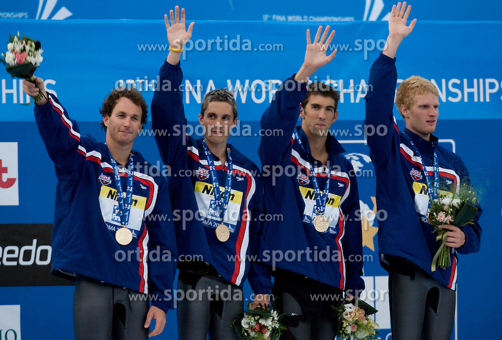 Aaron Peirsol, Eric Shanteau, Michael Phelps and David Walters of the United States receive the gold medal during the medal ceremony for the Men's 4x 100m Medley Relay Final at the 13th FINA World Championships Roma 2009, on August 2, 2009, at the Stadio del Nuoto,  in Foro Italico, Rome, Italy. (Photo by Vid Ponikvar / Sportida)