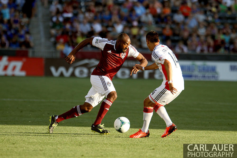 July 17th, 2013 - Colorado Rapids defender Marvell Wynne (22) attempts to bring the ball past New England Revolution forward Diego Fagundez (14) in the first half of action in the Major League Soccer match between the New England Revolution and the Colorado Rapids at Dick's Sporting Goods Park in Commerce City, CO