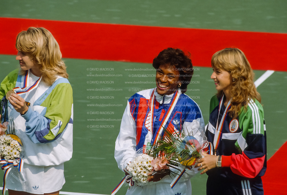 SEOUL, SOUTH KOREA - OCTOBER 1:  Steffi Graf of the Federal Republic of Germany (left), Zina Garrison of the United States (center), and Manuela Maleeva of Bulgaria (right) take part in the awards ceremony for the Women's Singles competition of the Tennis event of the 1988 Summer Olympic Games on October 1, 1988 at the Seoul Olympic Park Tennis Center in Seoul, South Korea.  Graf won the gold medal in the event, Garrison and Maleeva each won bronze medals.  (Photo by David Madison/Getty Images)