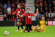 Adam Smith (15) of AFC Bournemouth is upset a foul was not awarded against Solly March (20) of Brighton and Hove Albion during the Premier League match between Bournemouth and Brighton and Hove Albion at the Vitality Stadium, Bournemouth, England on 15 September 2017. Photo by Graham Hunt.