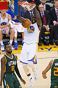 Golden State Warriors forward Draymond Green (23) dunks the ball against the Utah Jazz at Oracle Arena in Oakland, Calif., on December 20, 2016. (Stan Olszewski/Special to S.F. Examiner)