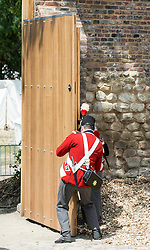 © London News Pictures. 17/06/2015. BELGIUM. <br />  Re-enactment which illustrated a deliberate reversal of the actions undertaken by their predecessaors 200 years ago, ten Guardsmen from No 7 Company Coldstream Guards, dressed for the occasion in 1815 period costume, carried out the official opening of the Gate.. 200 years since the eve of the Battle of Waterloo, Their Royal Highnesses The Prince of Wales and the Duchess of Cornwall attended a special ceremony at Hougoumont Farm, the Belgian Farm Wellington claimed was instrumental in his victory.  Photo credit: Sergeant Rupert Frere/LNP