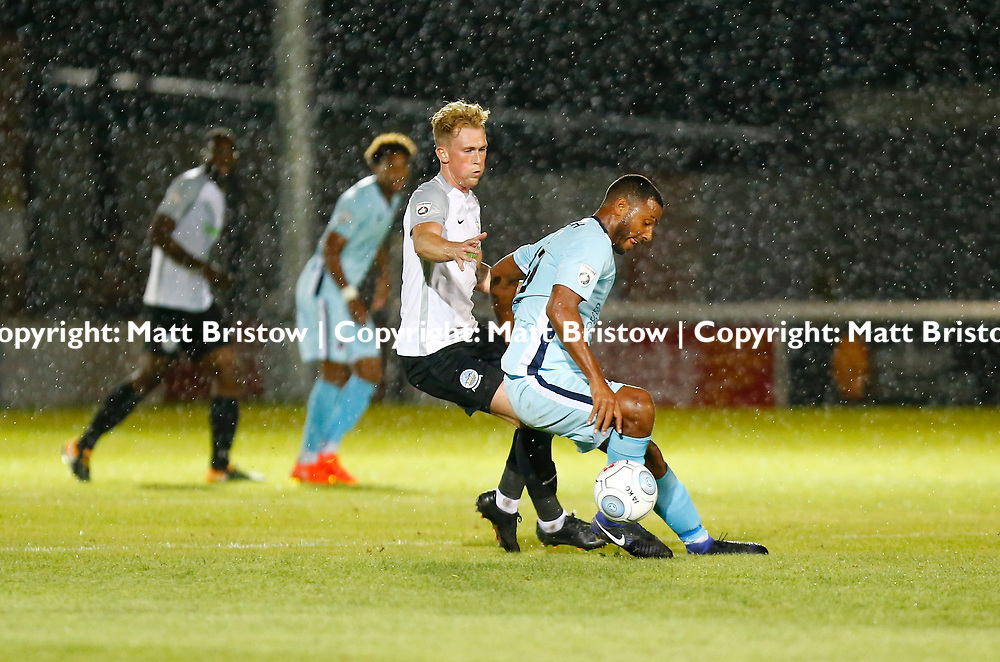 SEPTEMBER 12:  Top of the table Dover Athletic FChost eighth place Boreham Wood FC in Conference Premier at Crabble Stadium in Dover, England. The visitors, Boreham Wood  ran out winners a goal to nothing. Boreham Wood's Paul Benson with Dover's forward Mitchell Pinnock close behind. (Photo by Matt Bristow/mattbristow.net)
