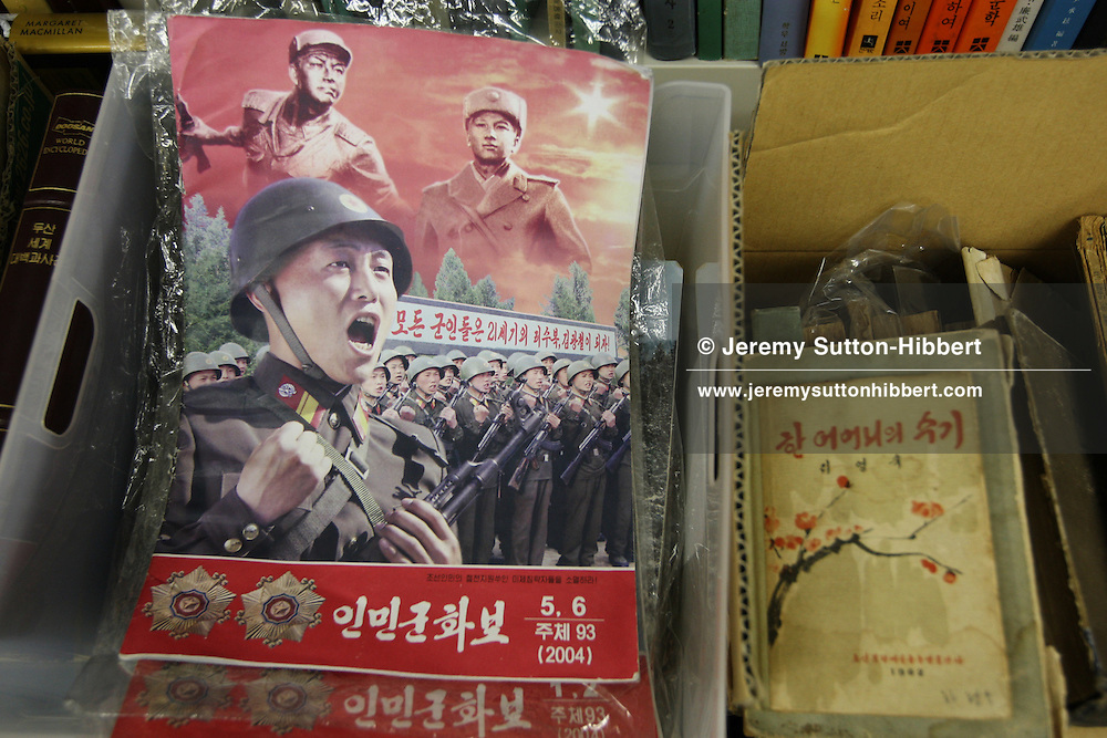 Mr. Jun Miyagawa, of the Rainbow Trading Company ( a North Korean speciality bookstore) shows off the North Korean products he has for sale ( including Kim Il Sung badges, North Korean bank notes, football memorabilia, cigarettes, and North Korean propaganda posters and genuine North Korean military uniforms), in his book store in Jimbocho district,  Tokyo, Japan, Friday, Aug. 17, 2007. All the products come via a contact of Mr Miyagawa's in China. The posters are individually painted and range in price from ¥50,000-¥150,000, the Kim Il Sung badges cost approximately JPN Yen 4,000.