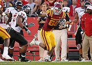 September 2 2010: Iowa State Cyclones tight end Collin Franklin (88) tries to hold off Northern Illinois Huskies linebacker Alex Kube (37) during the first half of the NCAA football game between the Northern Illinois Huskies and the Iowa State Cyclones at Jack Trice Stadium in Ames, Iowa on Thursday September 2, 2010.