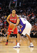Dec. 10 2010; Phoenix, AZ, USA; Portland Trailblazers guard Brandon Roy (7) handles the ball against Phoenix  Suns forward Jared Dudley (3) during the first half at the US Airways Center. Mandatory Credit: Jennifer Stewart-US PRESSWIRE.