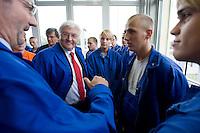 29 AUG 2008, EISENHUETTENSTADT/GERMANY:<br /> Frank-Walter Steinmeier (2.v.L.), SPD, Bundesaussenminister, und Matthias Platzeck (L), SPD, Ministerpraesident Brandenburg, im Gespraech mit Auszubildenden, waehrend dem Besuch des Stahlwerks ArcelorMittal Eisenhuettenstadt, der ehem. Eko Stahl, im Rahmen von Steinmeiers Sommerreise durch Brandenburg<br /> IMAGE: 20080829-01-037<br /> KEYWORDS: Eisenhüttenstadt, Blaumann