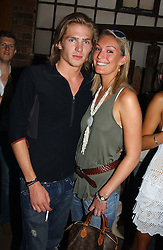 MR JACOBI ANSTRUTHER-GOUGH-CALHORPE and MISS OLIVIA BUCKINGHAM at a party in association with the Hurlingham Polo Association and AJM International publishing to celebrate the forthcoming Cartier International Polo day held at The Collection, 264 Brompton Road, London on 20th July 2004.