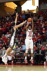 27 November 2015: Joseph Tagarelli looks for a block on a 3 point attempt by Deontae Hawkins(23). Illinois State Redbirds host the Quincy Hawks at Redbird Arena in Normal Illinois (Photo by Alan Look)