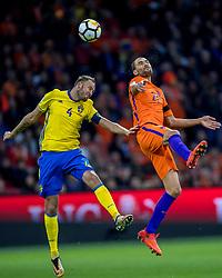 10-10-2017 NED: WK kwalificatie Nederland - Zweden, Amsterdam<br /> Oranje heeft Zweden met 2-0 verslagen. Het moest met zeven doelpunten verschil halen om nog kans te maken op plaatsing voor het WK. / Bas Dost #21 of Netherlands, Andreas Granqvist #4 of Sweden