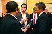© Licensed to London News Pictures. 11/09/2013. London, UK Nick Clegg © talks with Dr Evan Harris (L) and Hugh Grant. The Deputy Prime Minister, Nick Clegg, hosts a reception at Admiralty House in Whitehall this evening, 11 September 2013, to celebrate the government's progress in equal marriage. From next year gay people will be able to get married. A number of high profile guests including openly supportive celebrities, campaigners, religious figures and charities were in attendance.<br /> The London Gay Men Chorus Ensemble performed at the event. . Photo credit : Stephen Simpson/LNP