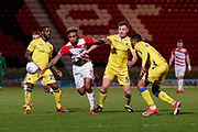 Mallik Wilks of Doncaster Rovers challenges Tony Craig of Bristol Rovers for the ball during the EFL Sky Bet League 1 match between Doncaster Rovers and Bristol Rovers at the Keepmoat Stadium, Doncaster, England on 26 March 2019.