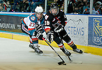 KELOWNA, CANADA, JANUARY 1: Jessey Astles #27 of the Kelowna Rockets checks Jake Virtanen #18 of the Calgary Hitmen as the Calgary Hitmen visit the Kelowna Rockets on January 1, 2012 at Prospera Place in Kelowna, British Columbia, Canada (Photo by Marissa Baecker/Getty Images) *** Local Caption ***