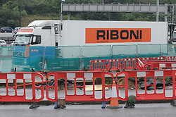 © Licensed to London News Pictures. 25/08/2014. Dartford.  The lorry in a lay-by at Dartford Crossing. 13 suspected illegal immigrants have been found in the back of a lorry at Darford River Crosing this morning (25.08.2014) about 11.30 am. One person has been taken to hospital while the immigration service investigate.<br />