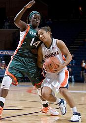 Virginia Cavaliers Guard Sharne? Zoll (5) heads towards the basket around Miami Hurricanes forward Charmaine Clark (14).  The University of Virginia Cavaliers defeated the Miami Hurricanes Women's Basketball Team 73-60 at the John Paul Jones Arena in Charlottesville, VA on February 4, 2007.