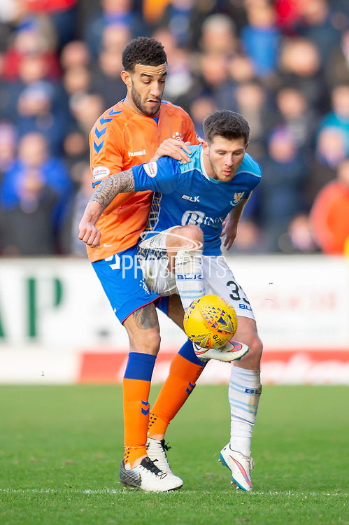 Matthew Kennedy (#33) of St Johnstone FC controls the ball in front of Connor Goldson (#6) of Rangers FC during the Ladbrokes Scottish Premiership match between St Johnstone FC and Rangers FC at McDiarmid Park, Perth, Scotland on 23 December 2018.