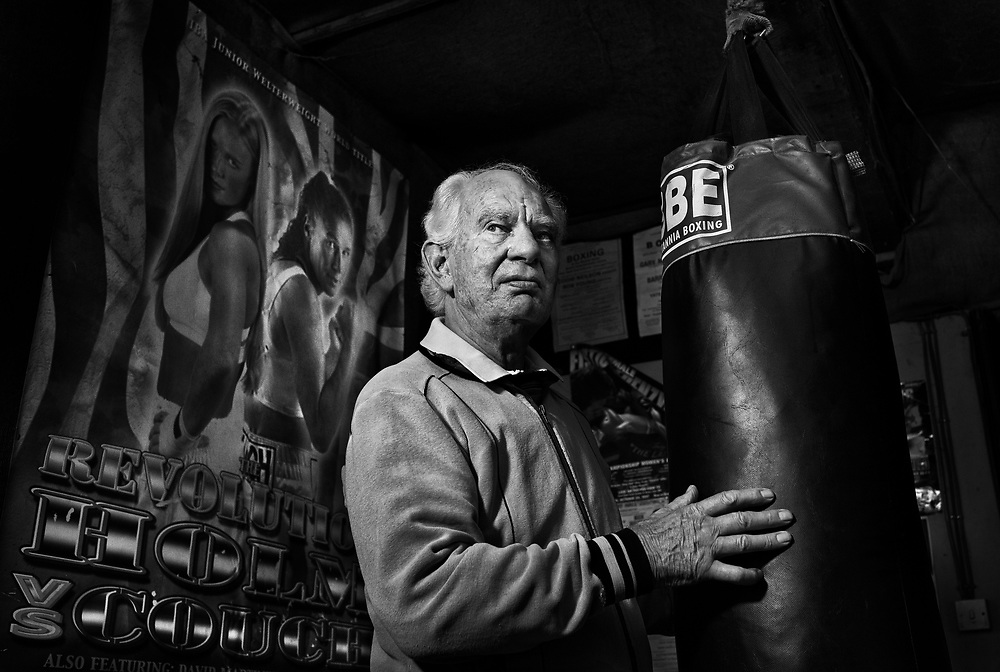 Tex Woodward, Spaniorum Farm Gymnasium.<br /> <br /> Tex Woodward began boxing in 1947 as a way of keeping fit. Despite being a very talented young footballer, his training and competitiveness led him to become a successful amateur boxer.<br /> <br /> After joining the RAF, he became a Physical Training Instructor and continued to box, winning various boxing championships including the prestigious 'Britannia Shield'. <br /> <br /> While in 'service' he trained many boxing champions and was the Commonwealth Games coach for the Ghana boxing team in 1958 and Welsh team in 1962.<br /> <br /> Leaving the RAF, he boxed professionally for a brief time, then set up the Spaniorum Farm Gymnasium in South Gloucestershire, <br /> where he coached and managed many more champion boxers.<br /> <br /> (Please see Multimedia)