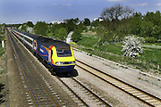 An East midlands Train passes through Northamptonshire near the weetabix plant and between the village of Isham and the town of Burton Latimer heading towards Kettering