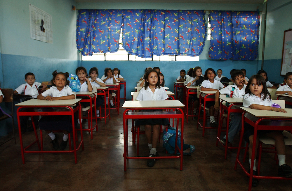 Children, many of them Colombian, sit in a classroom in Urena, a town on the border with Venezuela. Over 50% of the Colombians seeking refugee status in Venezuela are women and children.  Overall, there are about 2000 people seeking refugee status in Venezuela, most of whom are Colombians who have fled their country due to increasing violence caused by the conflict in Colombia.  Unable to return to Colombia for fear for their lives, and unable to obtain legal refugee status in Venezuela, many Colombian families live along the border.