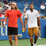 STEFANOS TSISPAS and NICK KYRGIOS  play doubles at the Rock Creek Tennis Center.