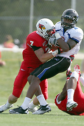 15 September 2012:  Ben Ericksen wraps up Chavar Watkins during an NCAA football game between the Eastern Illinois Panthers and the Illinois State Redbirds at Hancock Stadium in Normal IL