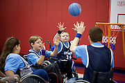 "Kellogg Foundation Assignment: Wheelchair Basketball..Conner Riffenhouse raises his hands to catch a pass made by his teammate...The contact is Pam Patula, 888/957-6245 runs an organization.called Socil (S.E. center for Independent Living )a member of April.  A weekly wheelchair basketball game in Lancaster, held on Jan 20th. Saturday at 10am. The basketball coach, Brett Harbage, is an Independent Living Specialist from SOCIL.  Other coach is Cheryl ""Hutch"" Hutchinson, she is the adaptive physical education instructor of Fairfield County.  The adaptive basketball games are part of the Upward Basketball league, .  This is only Upwards adaptive league in the nation."