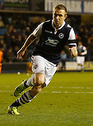 Millwall FC Midfielder Shane Ferguson scores his second of the game and heads off to celebrate his goal during the Sky Bet League 1 match between Millwall and Colchester United at The Den, London, England on 21 November 2015. Photo by Andy Walter.