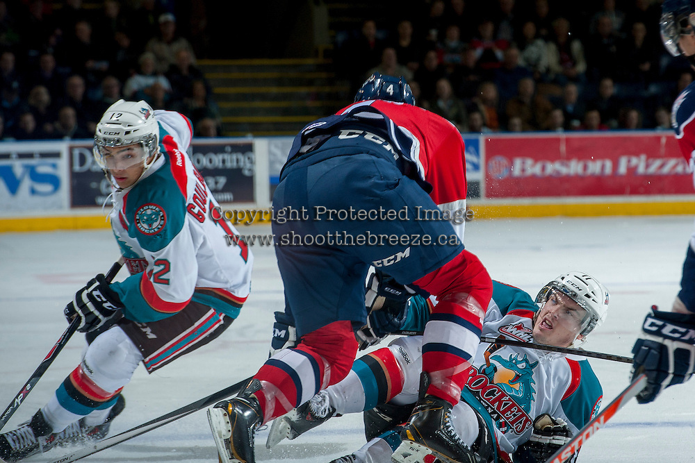 KELOWNA, CANADA -FEBRUARY 19: Matthew Gelinas #4 of the Tri City Americans checks Carter Rigby #11 of the Kelowna Rockets to the ice as Tyrell Goulbourne #12 of the Kelowna Rockets skates around on February 19, 2014 at Prospera Place in Kelowna, British Columbia, Canada.   (Photo by Marissa Baecker/Getty Images)  *** Local Caption *** Matthew Gelinas; Carter Rigby; Tyrell Goulbourne;