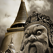 A stone statue guarding the Phra Sri Ratana Chedi within Wat Phra Kaeo temple, Royal Palace, Bangkok, Thailand.<br />