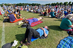© Licensed to London News Pictures. 05/07/2017. London, UK. People queue for tickets on day three of The Championships at Wimbledon.  Many tennis fans have camped overnight in Wimbledon Park to secure a place in the ticket queue. Photo credit : Stephen Chung/LNP