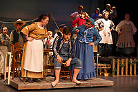 Gabby Laeclerc as Miss Watson and Doreen Sheppard as Widow Douglas giving Riley Alward as Huck Finn advice during dress rehearsal for Big River with the Streetcar Company at Interlakes High School auditorium on Tuesday evening.  (Karen Bobotas/for the Laconia Daily Sun)