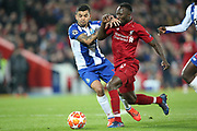 Liverpool midfielder Naby Keita (8) and FC Porto defender Alex Telles (13) during the Champions League Quarter-Final Leg 1 of 2 match between Liverpool and FC Porto at Anfield, Liverpool, England on 9 April 2019.