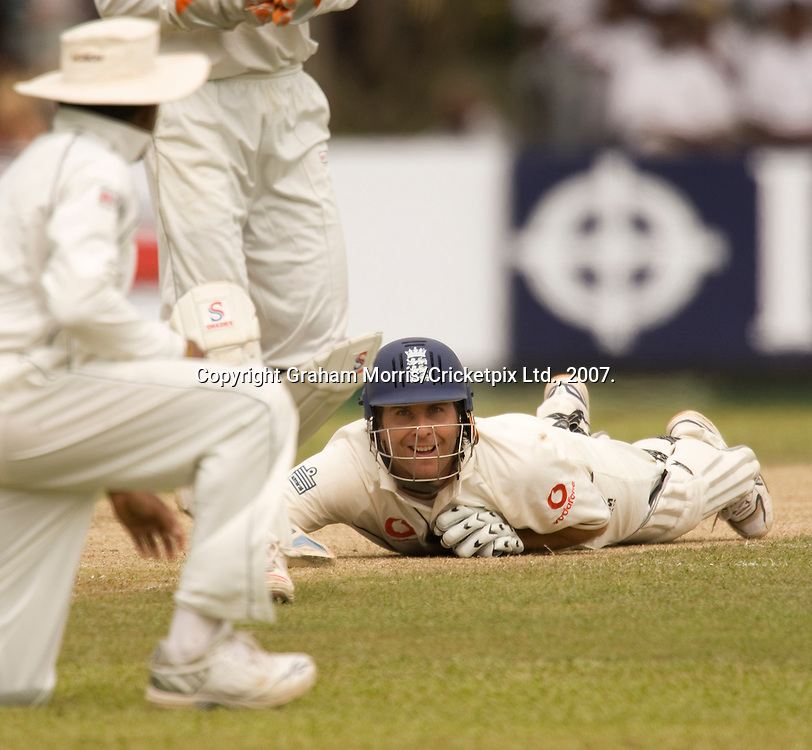 Michael Vaughan makes his ground after slip fielder Mahela Jayawardene (left) tries to run him out off the bowling of Muttiah Muralitharan during the first Test Match between Sri Lanka and England at the Asgiriya Stadium, Kandy. Photograph © Graham Morris/cricketpix.com (Tel: +44 (0)20 8969 4192; Email: sales@cricketpix.com)