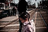 Young girl crossing the street at Spadina Avenue, Toronto, Canada