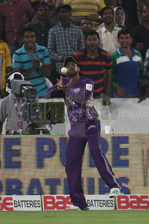Shoaib Malik of the Hobart Hurricanes gets under the ball to take the catch to get Manish Pandey of the Kolkata Knight Riders wicket during the first semi final match of the Oppo Champions League Twenty20 between the Kolkata Knight Riders and the Hobart Hurricanes held at the Rajiv Gandhi Cricket Stadium, Hyderabad, India on the 2nd October 2014<br /> <br /> Photo by:  Shaun Roy / Sportzpics/ CLT20<br /> <br /> <br /> Image use is subject to the terms and conditions as laid out by the BCCI/ CLT20.  The terms and conditions can be downloaded here:<br /> <br /> http://sportzpics.photoshelter.com/gallery/CLT20-Image-Terms-and-Conditions-2014/G0000IfNJn535VPU/C0000QhhKadWcjYs