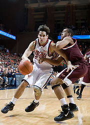 Virginia Cavaliers forward/center Ryan Pettinella (34) dribbles around Virginia Tech Hokies forward Coleman Collins (33). The Virginia Cavaliers Men's Basketball Team defeated the Virginia Tech Hokies 69-56 at the John Paul Jones Arena in Charlottesville, VA on March 1, 2007.