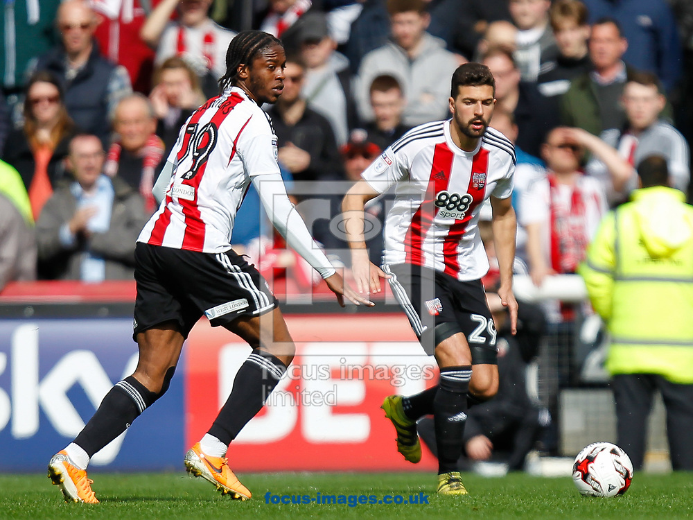 Romaine Sawyers of Brentford and Yoann Barbet of Brentford during the Sky Bet Championship match between Brentford and Bristol City at Griffin Park, London<br /> Picture by Mark D Fuller/Focus Images Ltd +44 7774 216216<br /> 01/04/2017