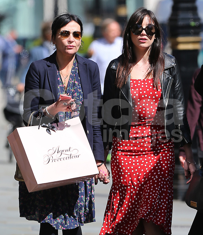 (EXCLUSIVE PICTURES) Model Daisy Lowe wearing a black leather bikers jacket, red &amp; white polka-dot dress and a pair of Chanel pumps, treats her mum Pearl Lowe for lunch at Scott's restaurant in Mayfair, London, UK. 20/04/2016 <br /> BYLINE MUST READ : JAMESY/GOTCHA IMAGES<br /> <br /> Copyright by &copy; Gotcha Images Ltd. All rights reserved.<br /> Usage of this image is conditional upon the acceptance <br /> of Gotcha Images Ltd, terms and conditions available at<br /> www.gotchaimages.com