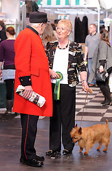 © Licensed to London News Pictures. 11/03/2012. A Chelsea Pensioner talks to a dog owner at the final day of the 2012 Crufts at the Birmingham NEC Arena.  With over 28,000 dogs taking part the tension is high as the competition draws towards the prestigious title of  Best in Show. Photo credit: Alison Baskerville/LNP