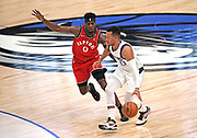 Dallas Mavericks point guard Jalen Brunson (13) comes off the bench in the second half to lead the Mavericks while being guarded by Toronto Raptors guard Terence Davis (0)during an NBA basketball game, Saturday, Nov. 16, 2019, in Dallas. The Mavericks defeated the Raptors 110-102. (Wayne Gooden/Image of Sport)