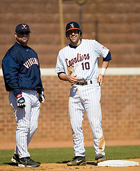 Virginia Cavaliers INF Tyler Cannon (10) shares a smile at third base with assistant coach Karl Kuhn after hitting a triple against Cornell.  The #16 ranked Virginia Cavaliers baseball team defeated the Cornell Big Red 12-2 at the University of Virginia's Davenport Field in Charlottesville, VA on March 1, 2008.