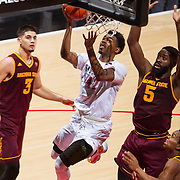 10 December 2016: The San Diego State Aztecs men's basketball team host's Saturday afternoon at Viejas Arena.  San Diego State guard Jeremy Hemsley (42) cuts through the Arizona State defense for a lay up in the first half. The Aztecs lead the Sun Devils 32-25 at half time. www.sdsuaztecphotos.com