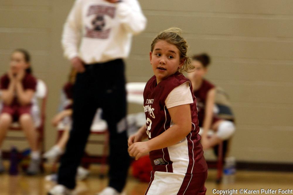 Elli Rose Focht plays basketball for her school team.