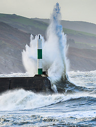 © Licensed to London News Pictures. 07/12/2017. Aberystwyth, UK. The southern edge of Storm Caroline, with winds gusting between 40 and 60 mph, brings huge waves crashing into the sea defences in Aberystwyth, Ceredigion, west Wales UK..Photo credit: Keith Morris/LNP